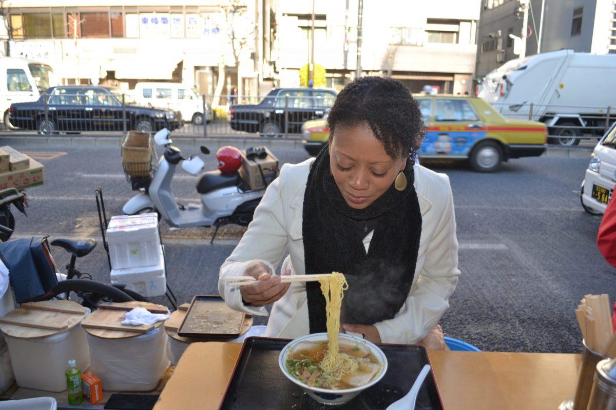 Travel Blogger Mia Herman eating noodles in Japan