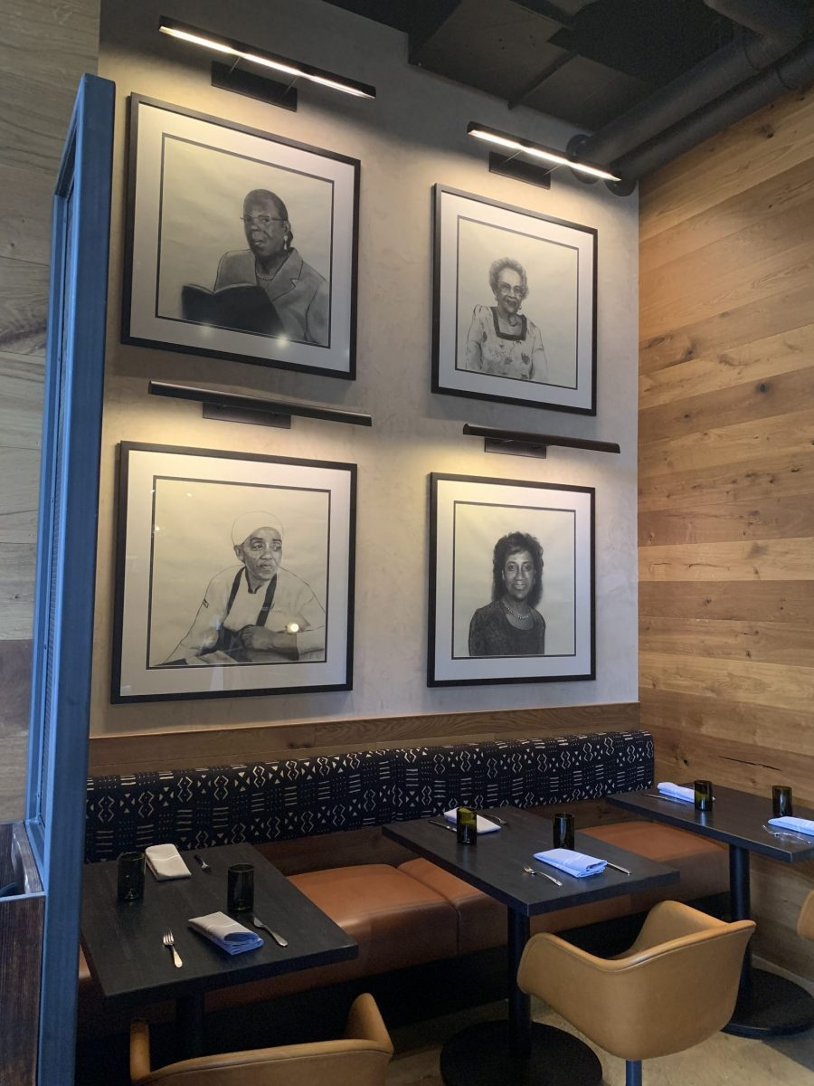 Portraits of African-American women on the wall at Benne in Ashville