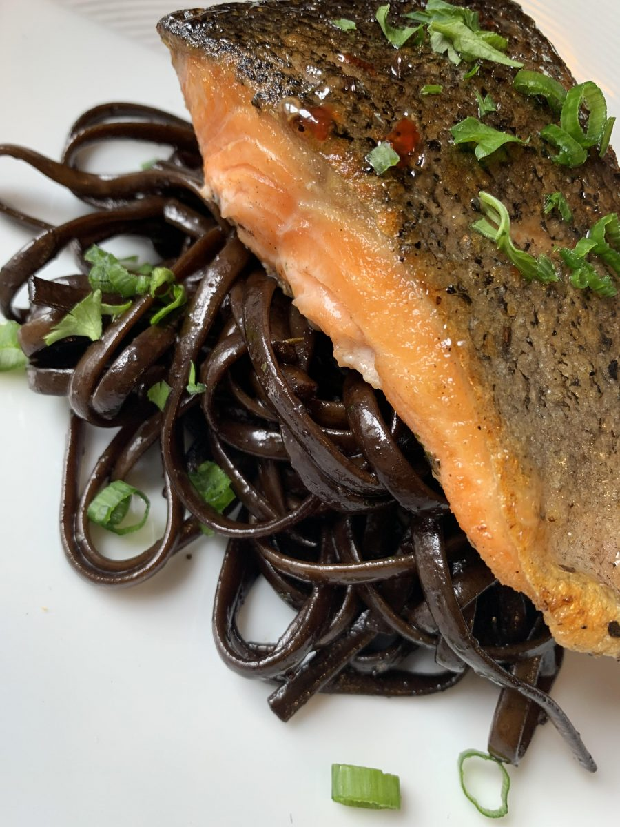 Salmon over black noodles by Chef Jeff Morneau