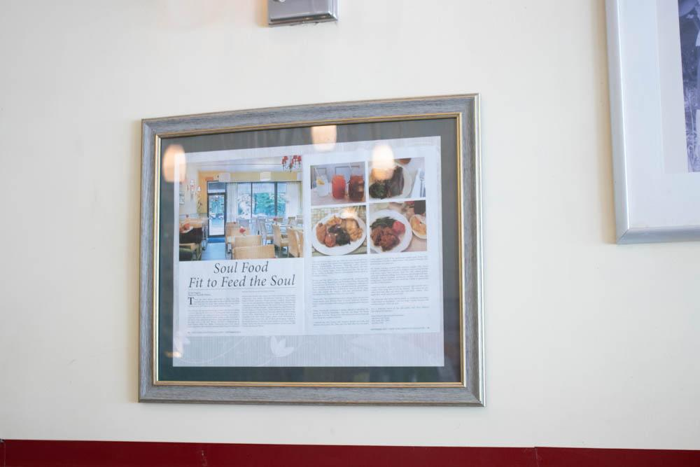 Print article framed on the wall of Miss Mamie's Spoonbread Too in Harlem