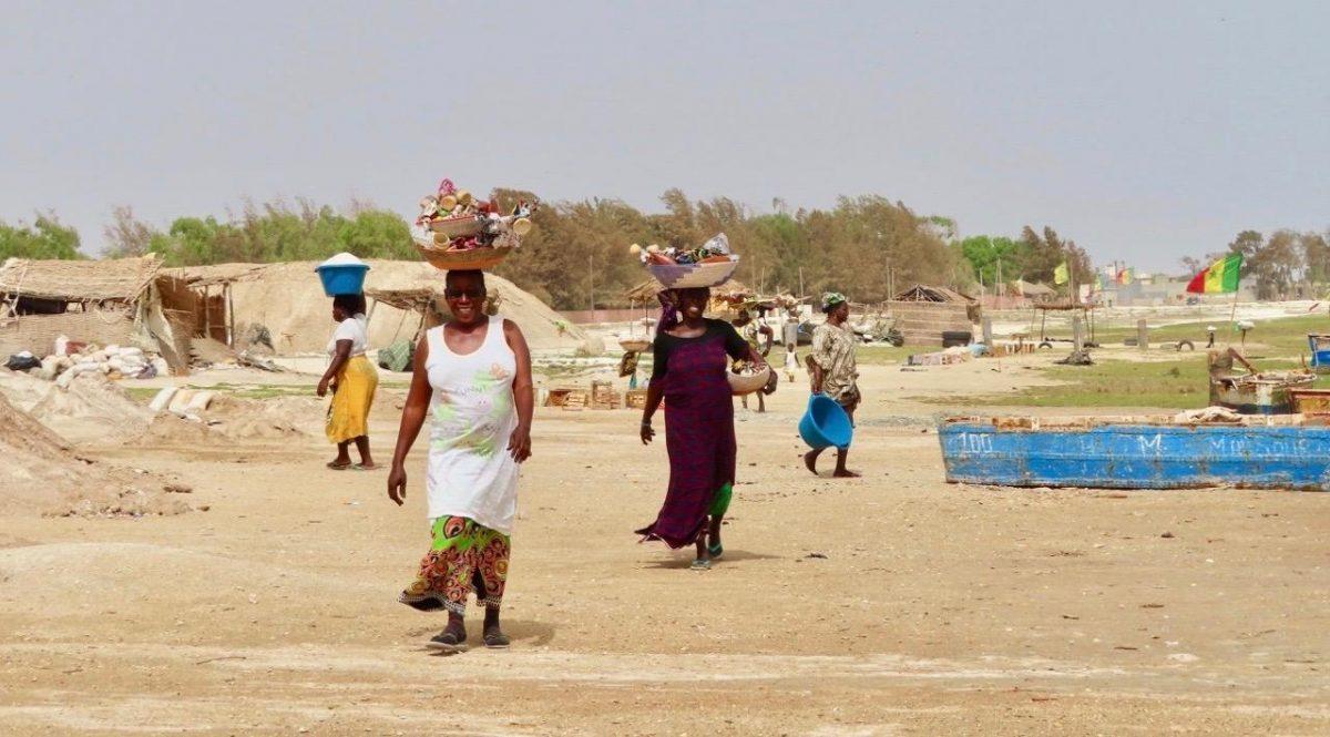 Women in Senegal working around The Pink Lake