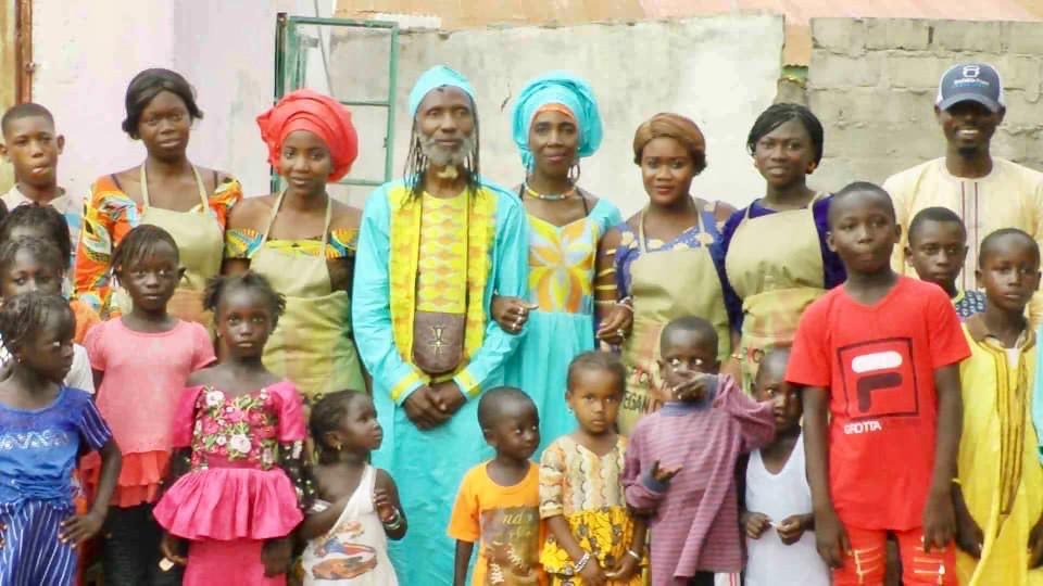 Naasira Ageela and Dr. Joe Bledsoe with Students and Neighbors in The Gambia
