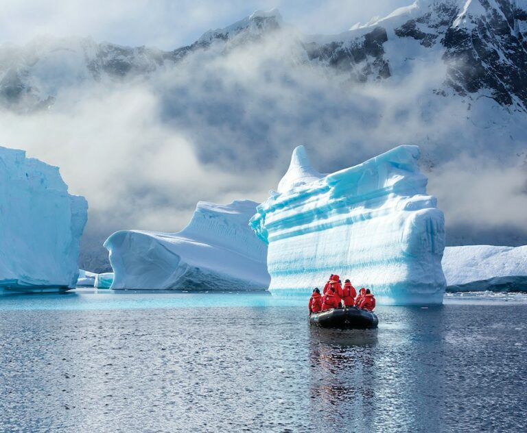 Guests from the Lindblad Expedition ship National Geographic Explorer enjoy icebergs at Booth Island, Antarctica by Zodiac.