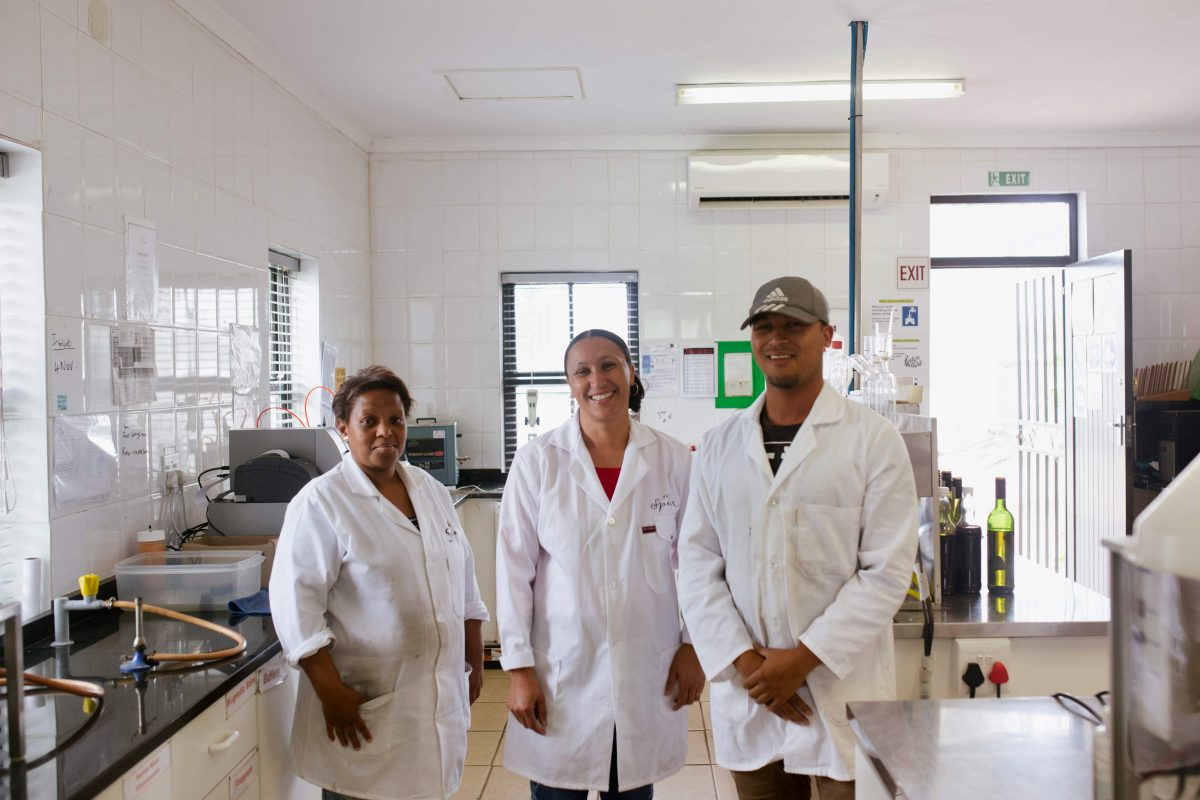 Merecia Smith with her son and lab assistant in South Africa