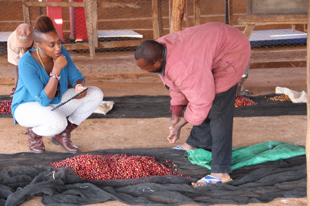 Vava Angwenyi with coffee producers in Kenya