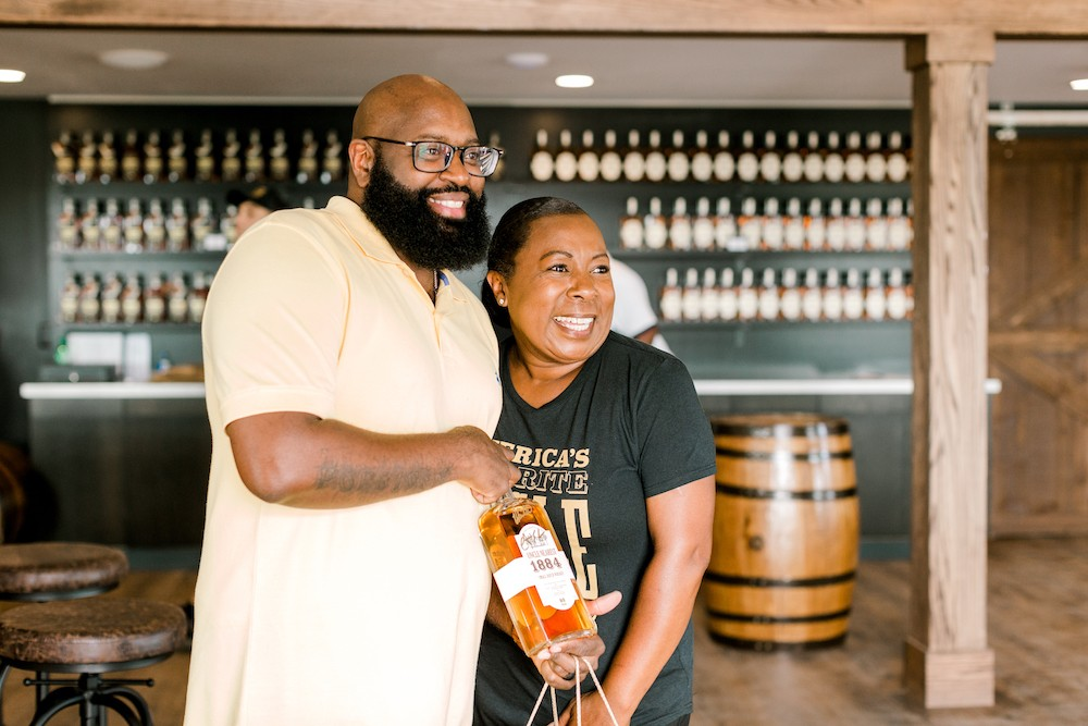 Victoria Butler with a guest at Uncle Nearest Distillery