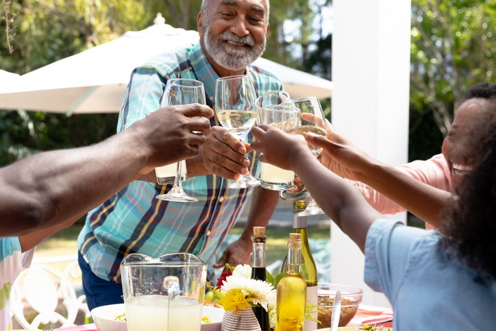 Black family toasting wine