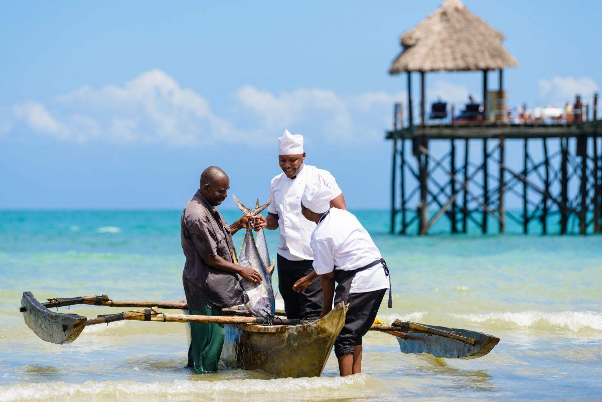 Team members at Zanzi Resort catching fish of the day