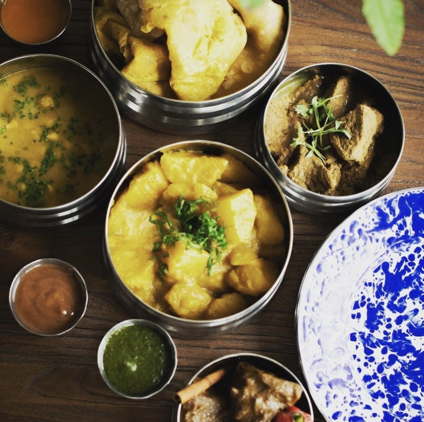 Omnivore and herbivore Curries in tiffin boxes at Cane