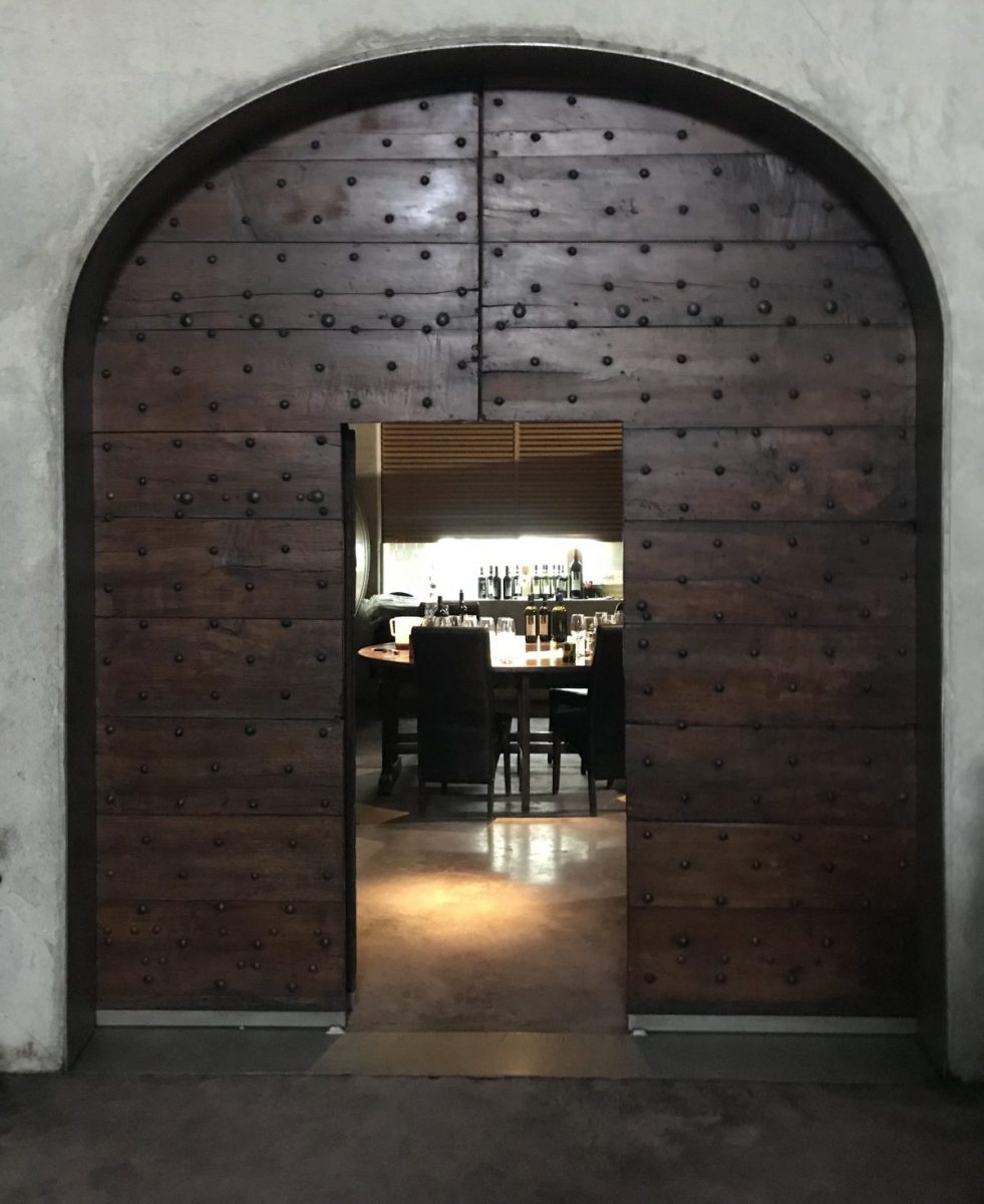 Il Palazzo's aging room doorway in Tuscany