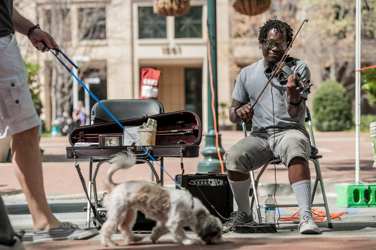 Street artist playing the violin at Soda City Market in Columbia, SC