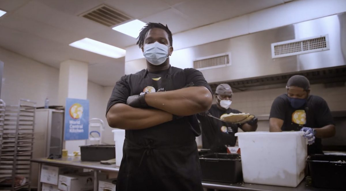 Chef Ameer Natson serving for World Central Kitchen