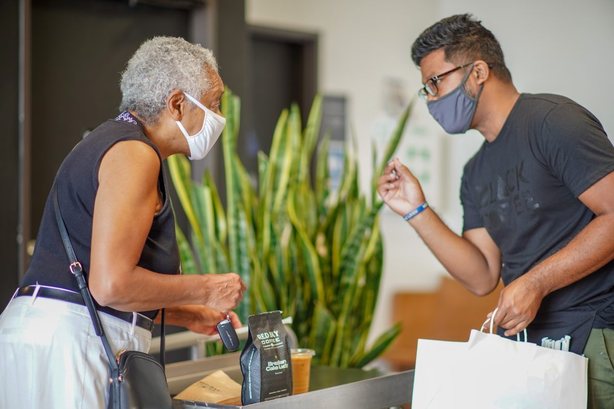 Red Bay Coffee employee selling coffee to a customer