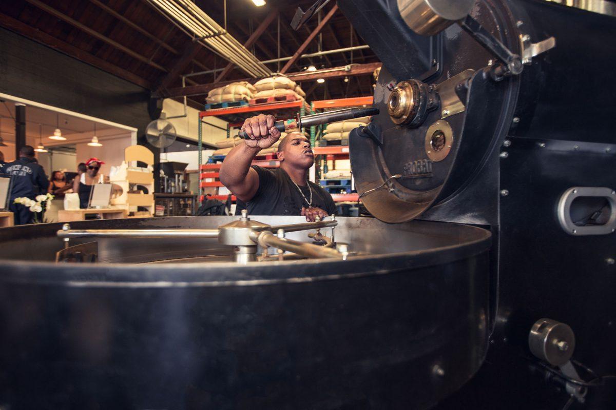 Red Bay Coffee employee roasting coffee