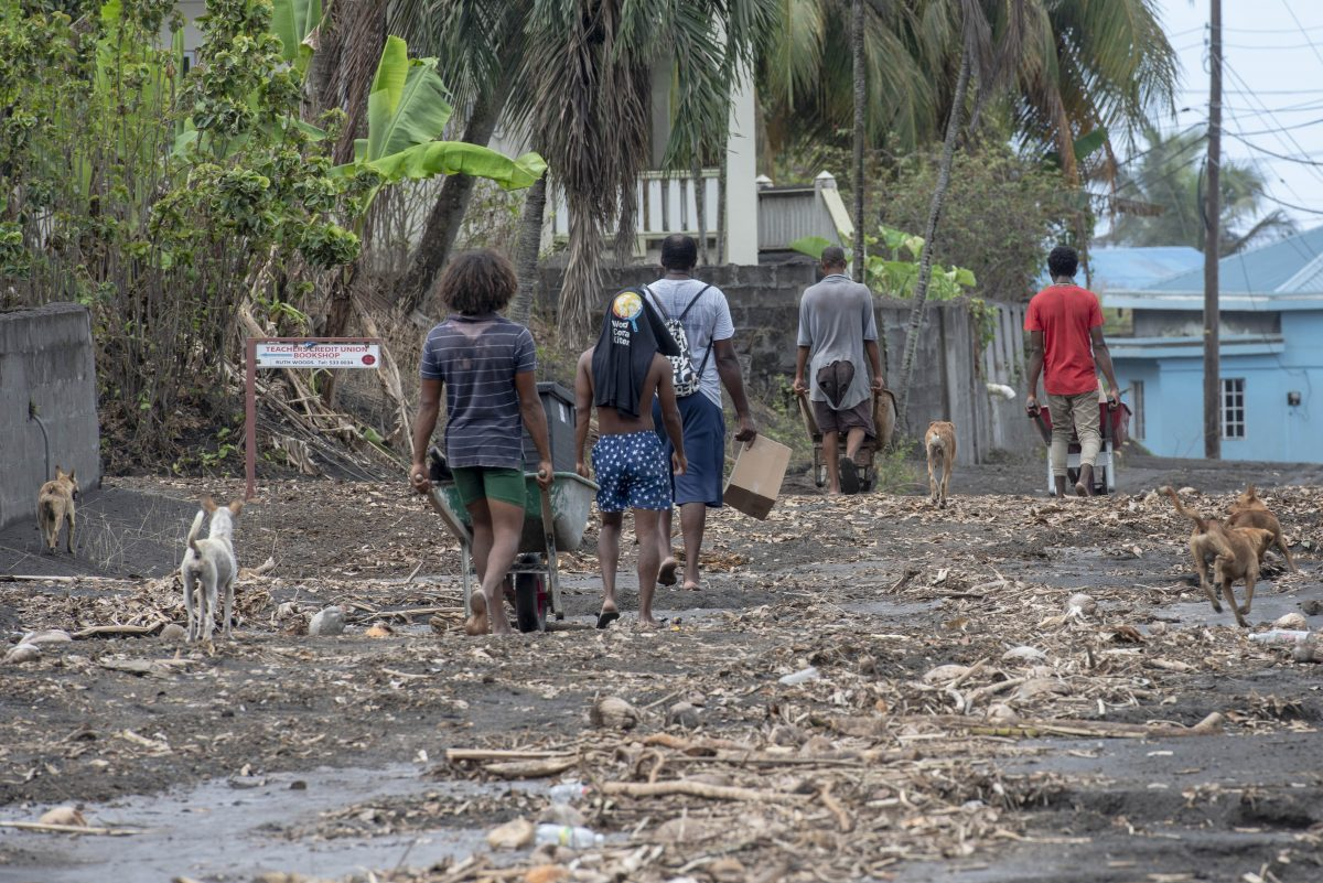 Residents in St. Vincent and The Grenadines walking through the aftermath of the volcano eruption