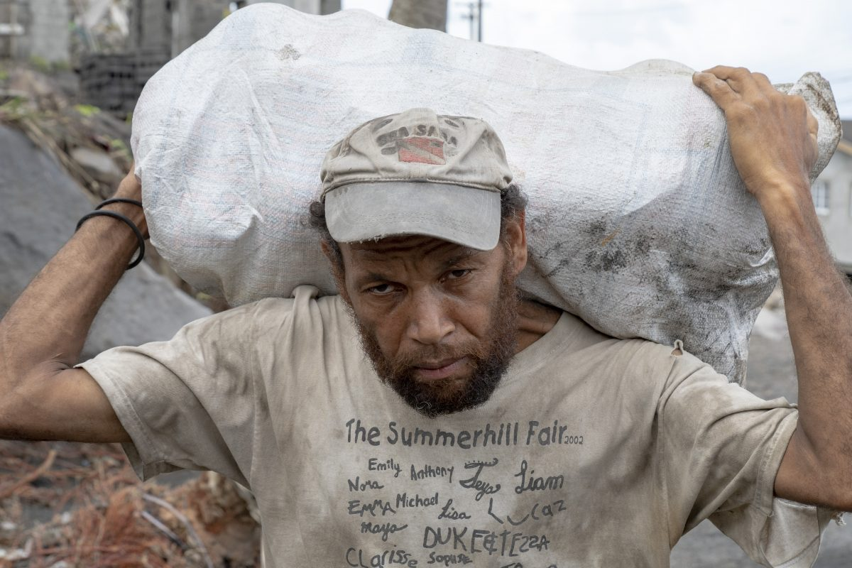 Resident of St. Vincent and The Grenadines carry product on is back