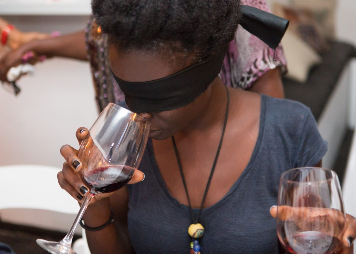 Woman blind tasting wine at an event at Sai Wine and Champagne Café in Ghana