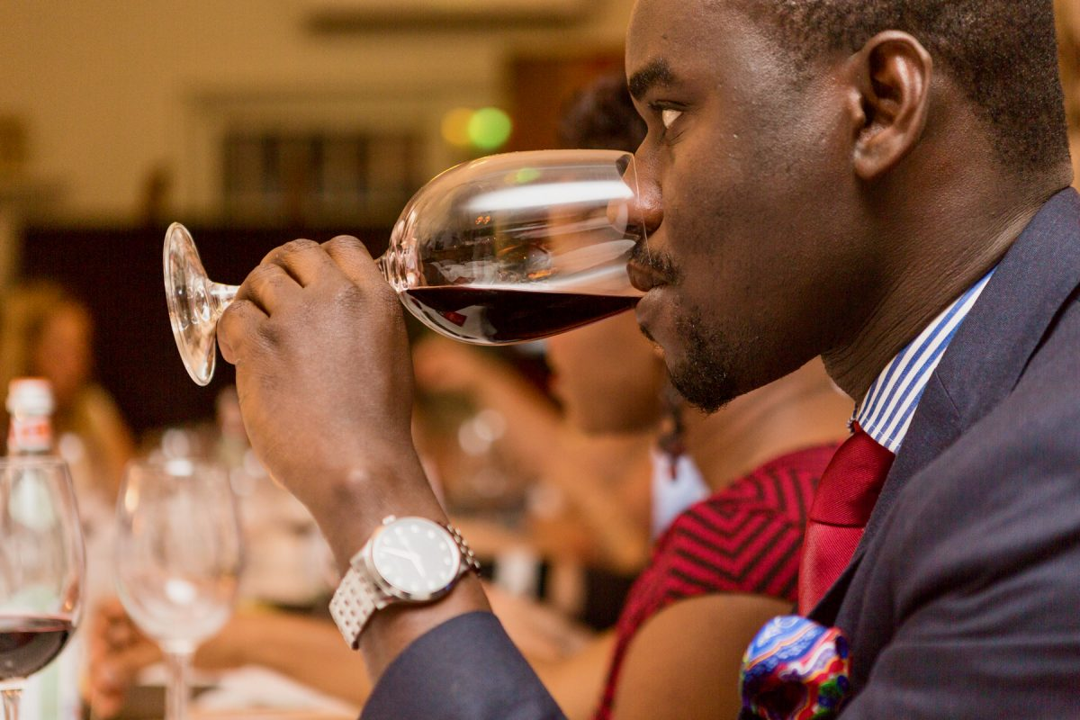 Man attending a wine tasting event at Sai Wine and Champagne Café