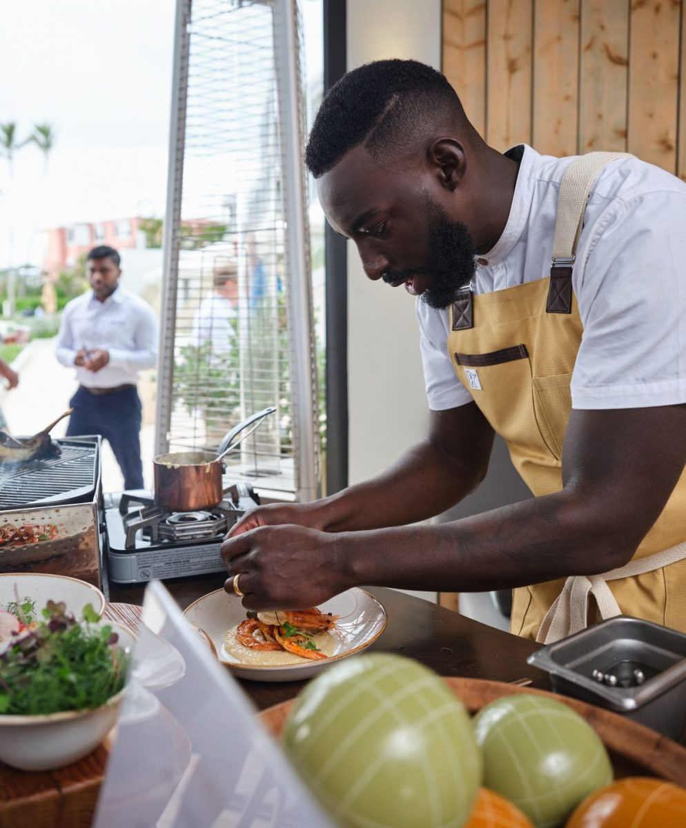 Chef Eric Adjepong cooking