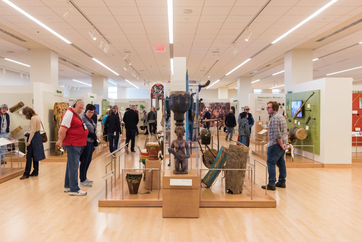 Attendees walking through an exhibit at Musical Instrument Museum