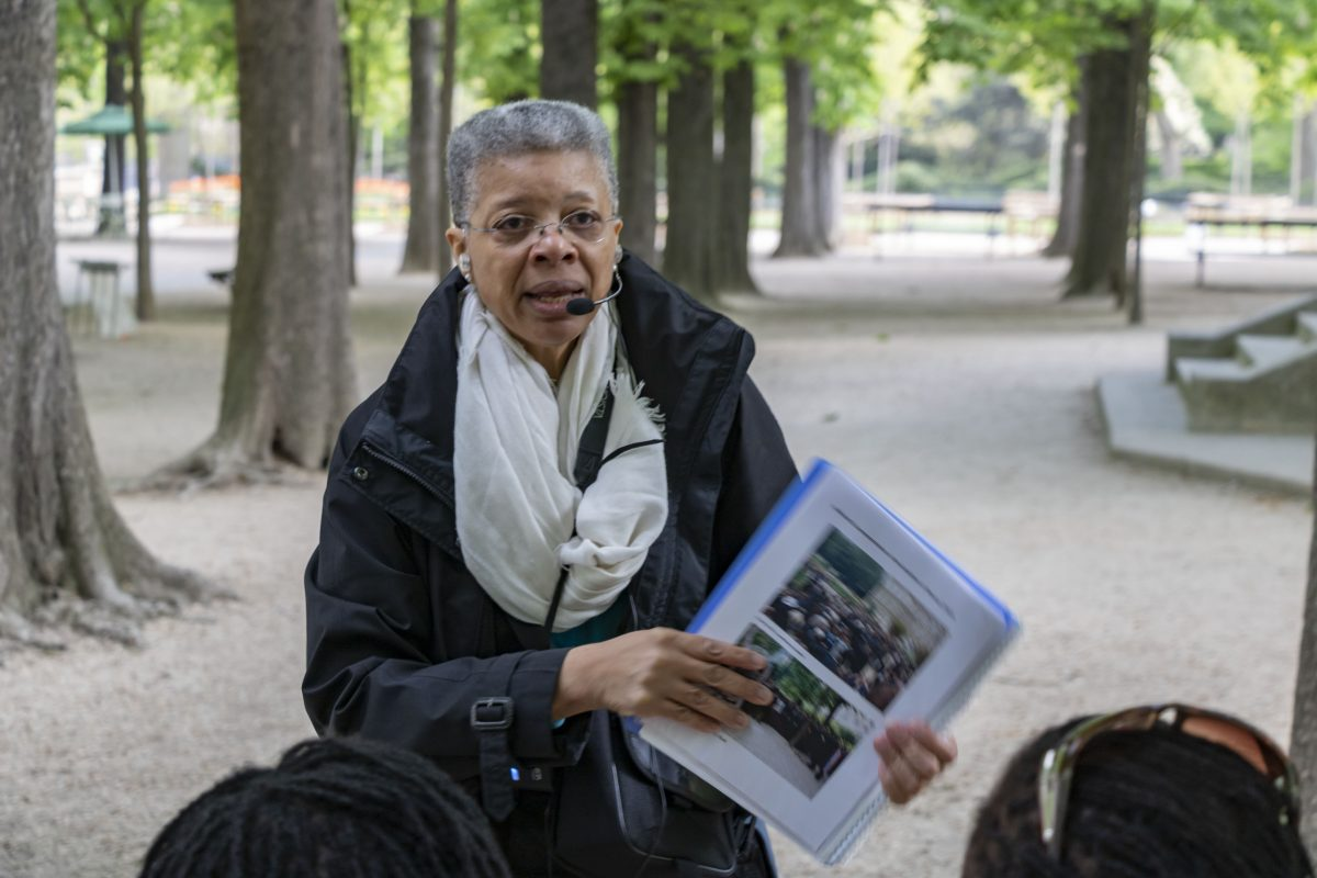 Monique Wells giving a tour in Paris