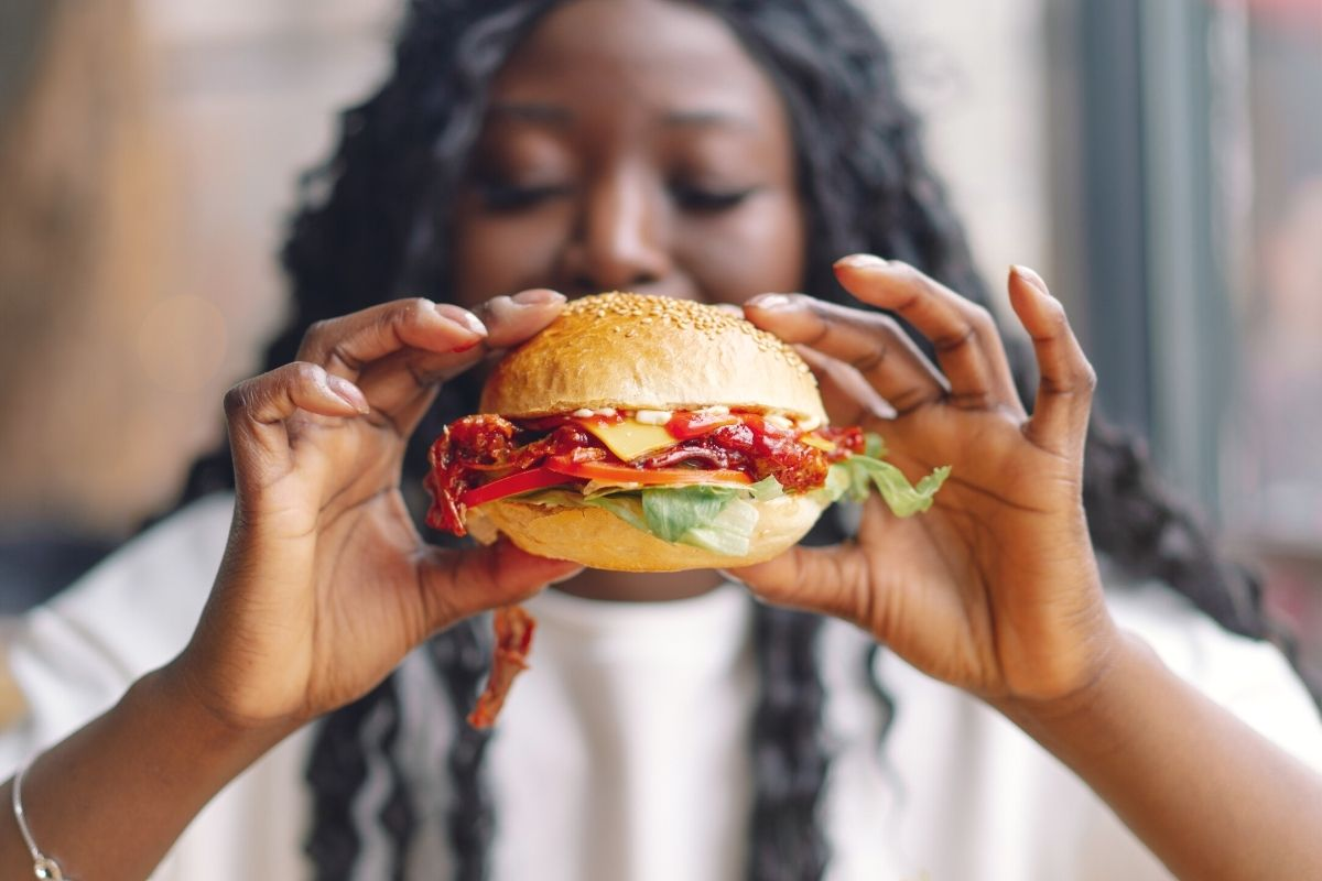 Woman about to eat a sandrw